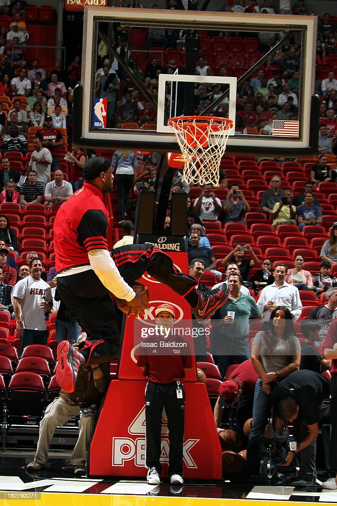 <a gi-track='captionPersonalityLinkClicked' href=/galleries/search?phrase=LeBron+James&family=editorial&specificpeople=201474 ng-click='$event.stopPropagation()'>LeBron James</a> #6 of the Miami Heat dunks during pregame warm ups before the game against the Sacramento Kings on February 26, 2013 at American Airlines Arena in Miami, Florida.