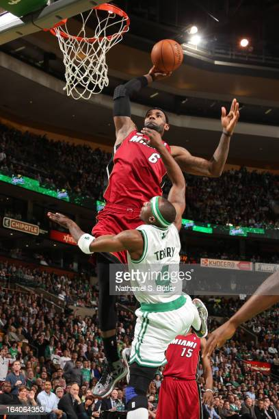 LeBron James of the Miami Heat dunks on an alleyoop pass against Jason Terry of the Boston Celtics on March 18 2013 at TD Garden in Boston...