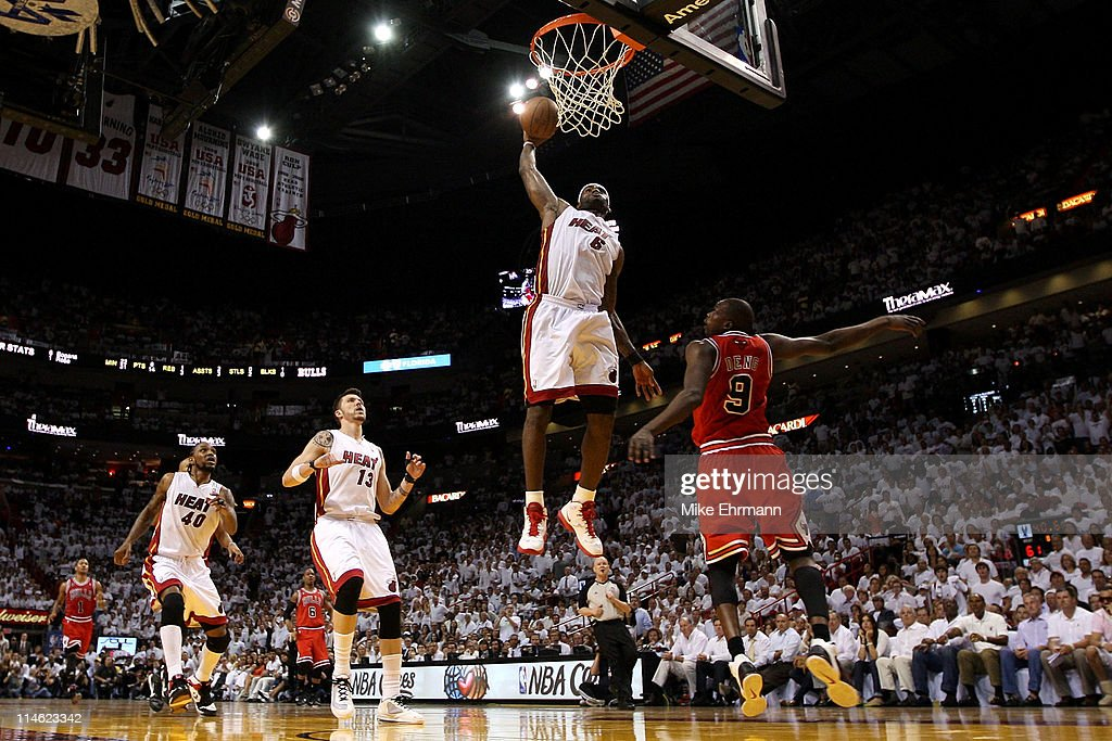 LeBron James #6 of the Miami Heat dunks on Luol Deng #9 of the Chicago Bulls in Game Four of the Eastern Conference Finals during the 2011 NBA Playoffs on May 24, 2011 at American Airlines Arena in Miami, Florida.