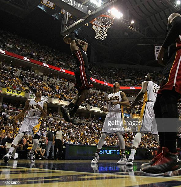 LeBron James of the Miami Heat dunks over George Hill David West and Roy Hibbert of the Indiana Pacers on his way to a gamehigh 40 points in Game...