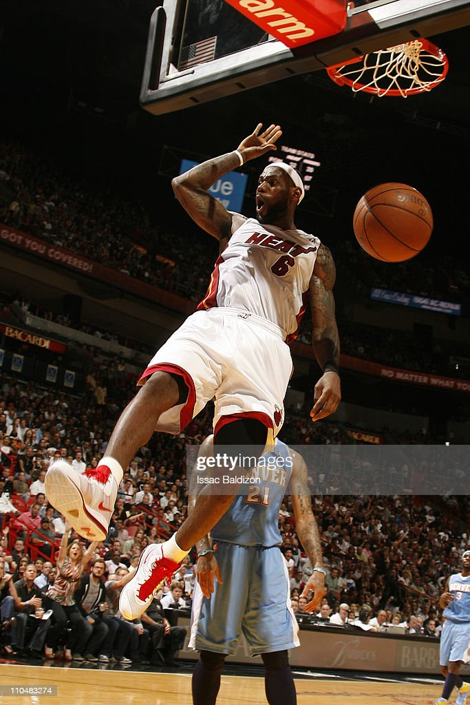 <a gi-track='captionPersonalityLinkClicked' href=/galleries/search?phrase=LeBron+James&family=editorial&specificpeople=201474 ng-click='$event.stopPropagation()'>LeBron James</a> #6 of the Miami Heat dunks over <a gi-track='captionPersonalityLinkClicked' href=/galleries/search?phrase=Wilson+Chandler&family=editorial&specificpeople=809324 ng-click='$event.stopPropagation()'>Wilson Chandler</a> #21 of the Denver Nuggets on March 19, 2011 at American Airlines Arena in Miami, Florida.