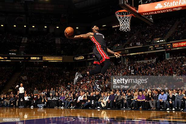 LeBron James of the Miami Heat dunks the ball during their game against the Sacramento Kings at Sleep Train Arena on December 27 2013 in Sacramento...