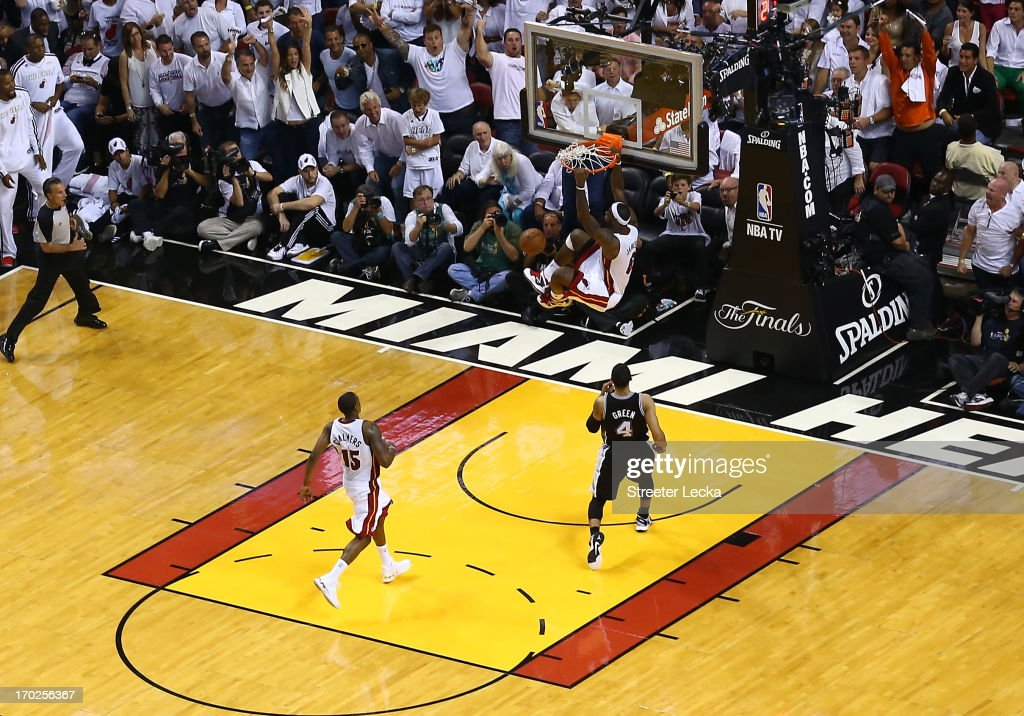 <a gi-track='captionPersonalityLinkClicked' href=/galleries/search?phrase=LeBron+James&family=editorial&specificpeople=201474 ng-click='$event.stopPropagation()'>LeBron James</a> #6 of the Miami Heat dunks the ball in the fourth quarter while taking on the San Antonio Spurs during Game Two of the 2013 NBA Finals at AmericanAirlines Arena on June 9, 2013 in Miami, Florida.