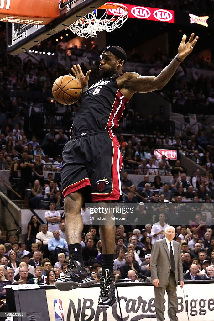 <a gi-track='captionPersonalityLinkClicked' href=/galleries/search?phrase=LeBron+James&family=editorial&specificpeople=201474 ng-click='$event.stopPropagation()'>LeBron James</a> #6 of the Miami Heat dunks the ball in the third quarter against the San Antonio Spurs during Game Four of the 2013 NBA Finals at the AT&T Center on June 13, 2013 in San Antonio, Texas.