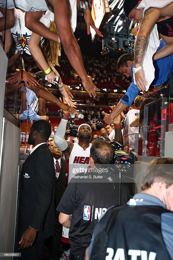 <a gi-track='captionPersonalityLinkClicked' href=/galleries/search?phrase=LeBron+James&family=editorial&specificpeople=201474 ng-click='$event.stopPropagation()'>LeBron James</a> #6 of the Miami Heat embraces fans during Game Two of the Eastern Conference Semifinals against the Brooklyn Nets in the 2014 NBA playoffs at American Airlines Arena in Miami, Florida on May 8, 2014.