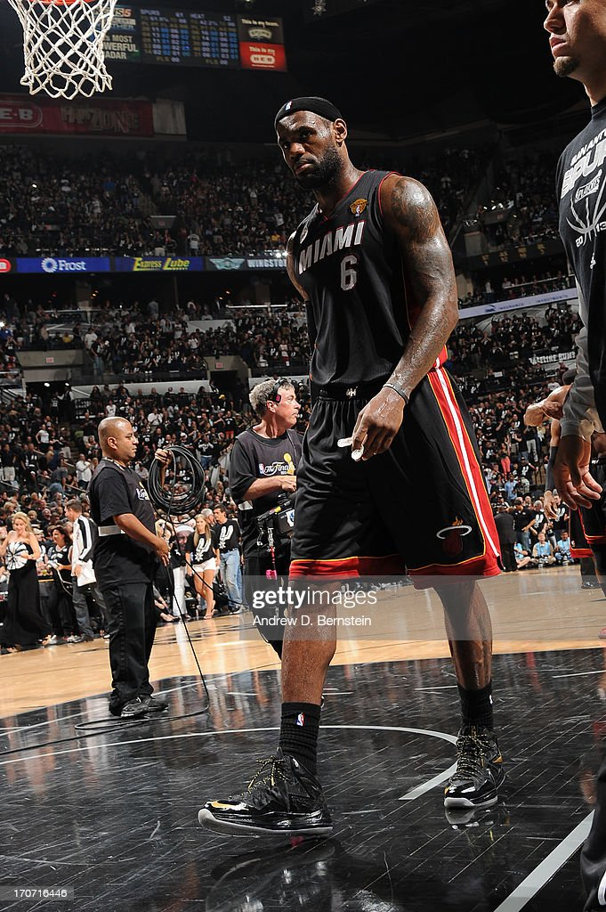 LeBron James #6 of the Miami Heat exits the court at halftime of Game Five of the 2013 NBA Finals on June 16, 2013 at the AT&T Center in San Antonio, Texas.