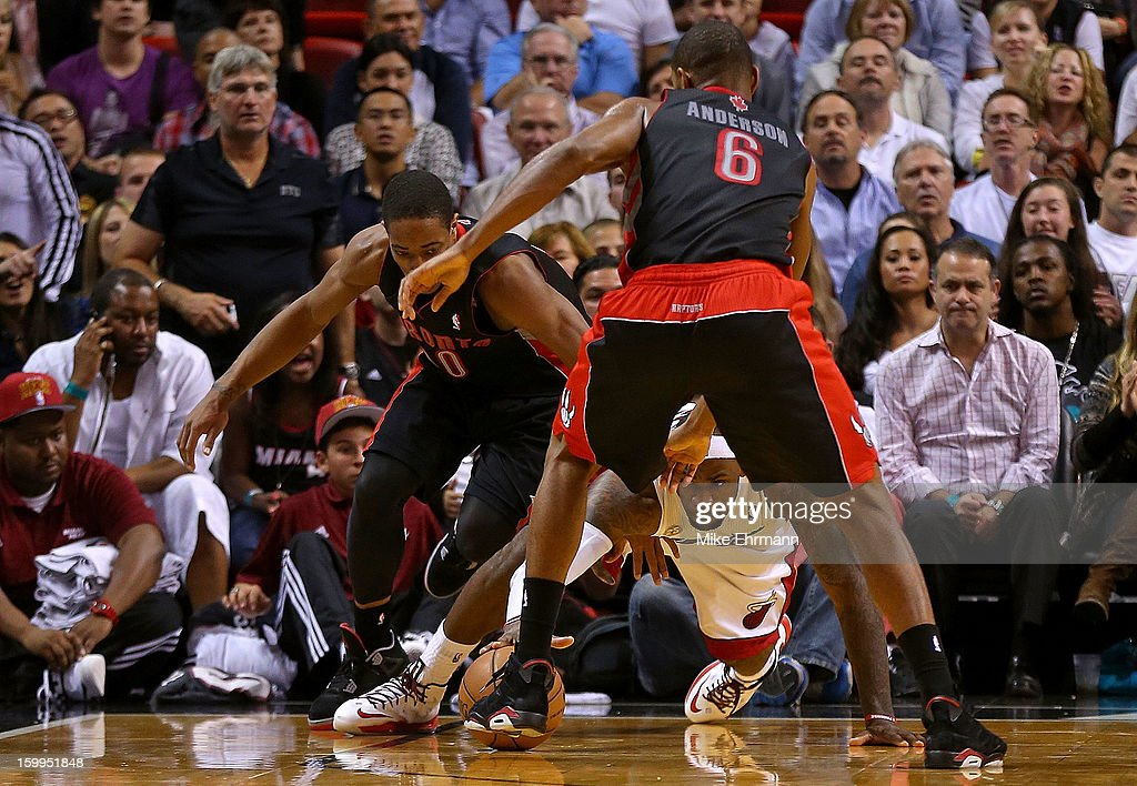 LeBron James #6 of the Miami Heat fights for a loose ball with Alan Anderson #6 of the Toronto Raptors during a game at American Airlines Arena on January 23, 2013 in Miami, Florida.