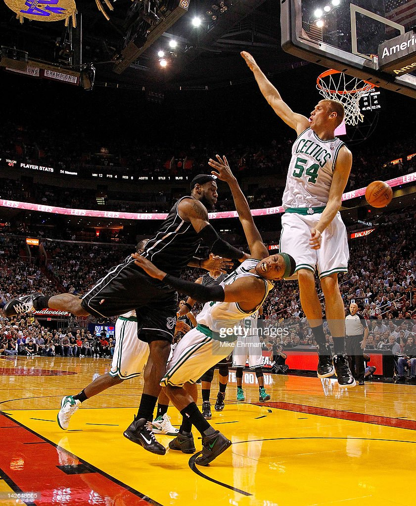 LeBron James of the Miami Heat fouls Paul Pierce of the Boston Celtics as Greg Stiemsma of the Boston Celtics tries to block the shot during a game...