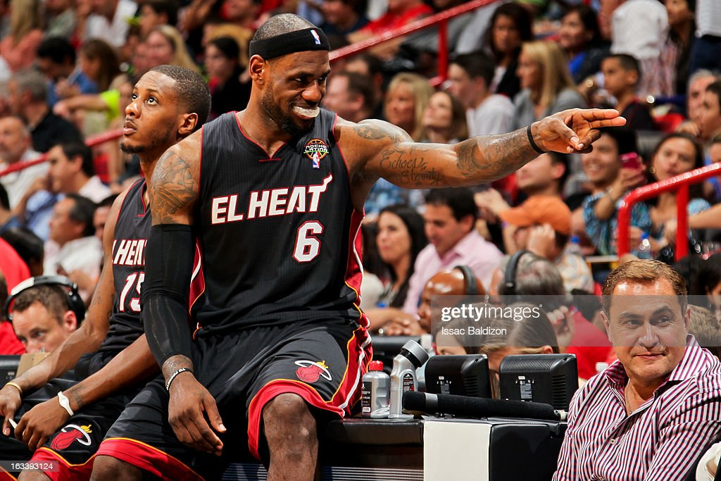 LeBron James #6 of the Miami Heat gestures to a teammate before resuming play action against the Philadelphia 76ers on March 8, 2013 at American Airlines Arena in Miami, Florida.