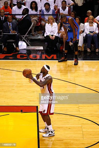 LeBron James of the Miami Heat gets set to attempt a technical free throw in the second half against Kevin Durant of the Oklahoma City Thunder looks...