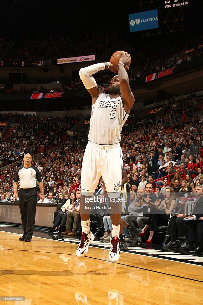 <a gi-track='captionPersonalityLinkClicked' href=/galleries/search?phrase=LeBron+James&family=editorial&specificpeople=201474 ng-click='$event.stopPropagation()'>LeBron James</a> #6 of the Miami Heat goes for a jump shot during the game between the Utah Jazz and the Miami Heat on December 22, 2012 at American Airlines Arena in Miami, Florida.