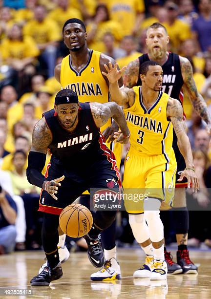 LeBron James of the Miami Heat goes for a loose ball against the Indiana Pacers during Game Two of the Eastern Conference Finals of the 2014 NBA...