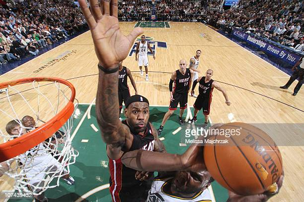 LeBron James of the Miami Heat goes for the block against Al Jefferson of the Utah Jazz at EnergySolutions Arena on December 08 2010 in Salt Lake...