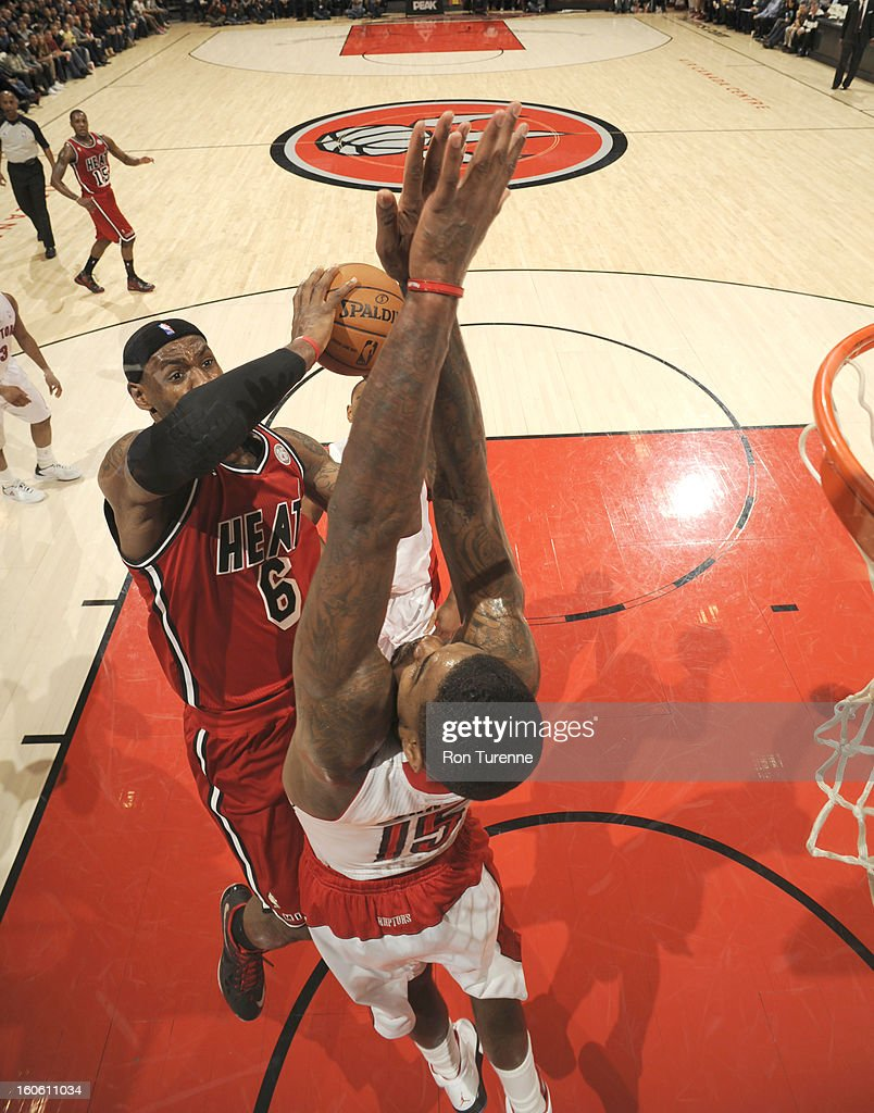 <a gi-track='captionPersonalityLinkClicked' href=/galleries/search?phrase=LeBron+James&family=editorial&specificpeople=201474 ng-click='$event.stopPropagation()'>LeBron James</a> #6 of the Miami Heat goes to the basket against <a gi-track='captionPersonalityLinkClicked' href=/galleries/search?phrase=Amir+Johnson&family=editorial&specificpeople=556786 ng-click='$event.stopPropagation()'>Amir Johnson</a> #15 of the Toronto Raptors during the game between the Toronto Raptors and the Miami Heat during the game on February 3, 2013 at the Air Canada Centre in Toronto, Ontario, Canada.