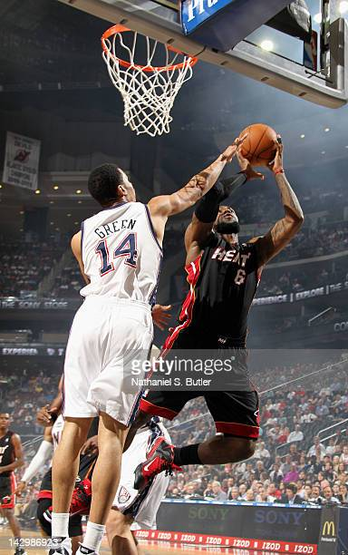 LeBron James of the Miami Heat goes to the basket against Gerald Green of the New Jersey Nets during the game on April 16 2012 at the Prudential...