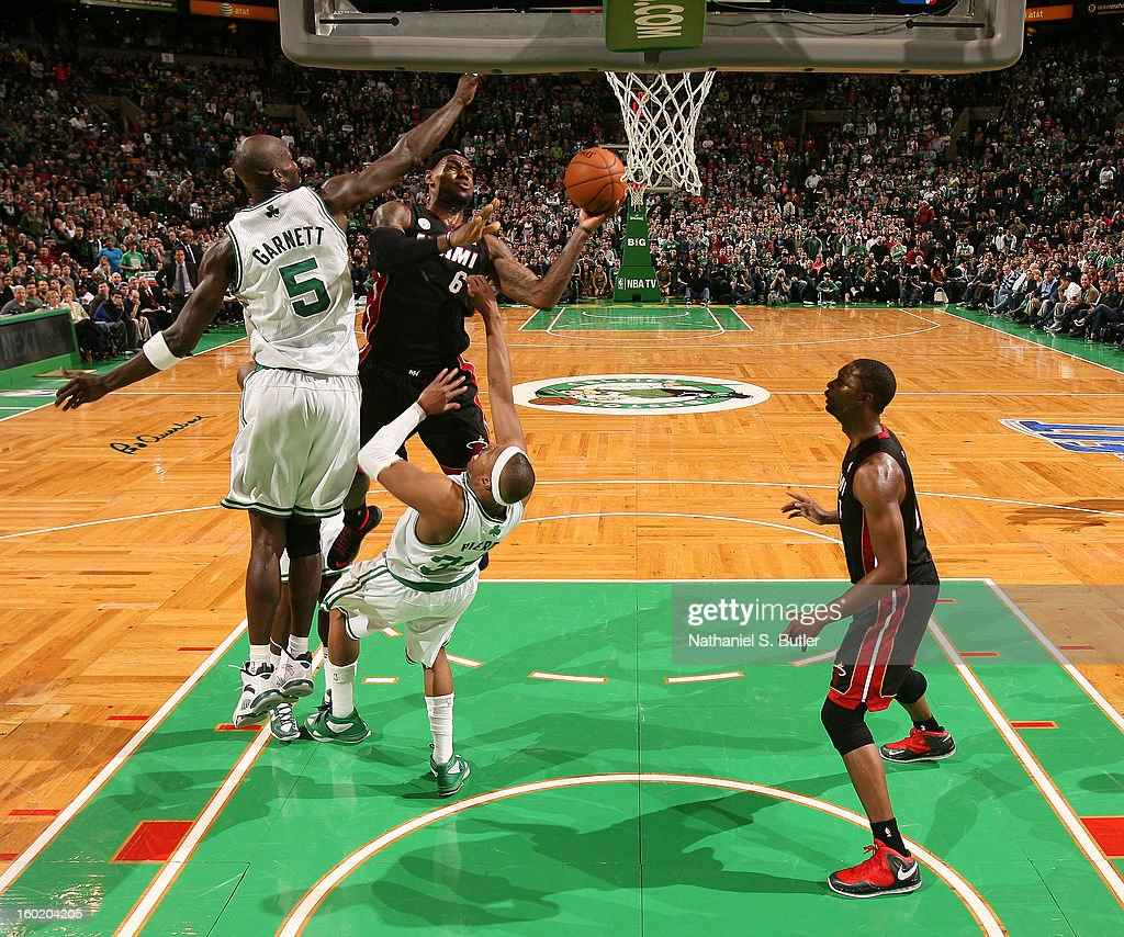 LeBron James #6 of the Miami Heat goes to the basket against Kevin Garnett #5 and Paul Pierce #34 of the Boston Celtics on January 27, 2013 at TD Garden in Boston, Massachusetts.