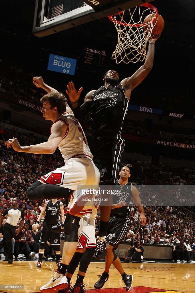 LeBron James #6 of the Miami Heat goes to the basket against Omer Asik #3 of the Chicago Bulls during the game on January 29, 2012 at American Airlines Arena in Miami, Florida.