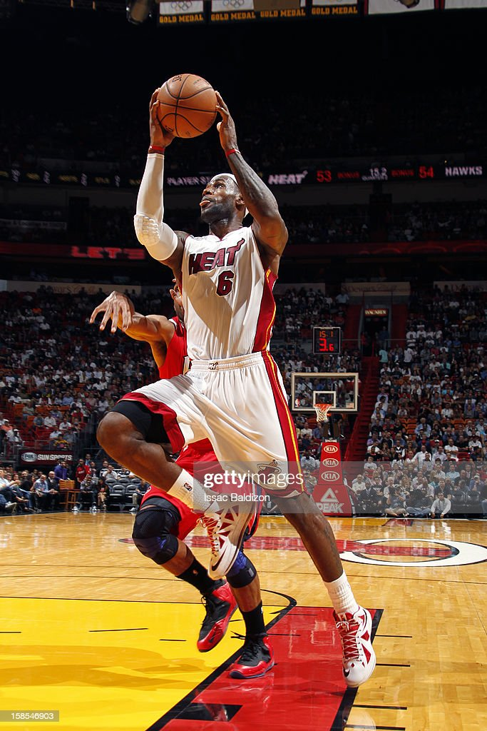 LeBron James #6 of the Miami Heat goes to the basket against the Atlanta Hawks on December 10, 2012 at American Airlines Arena in Miami, Florida.