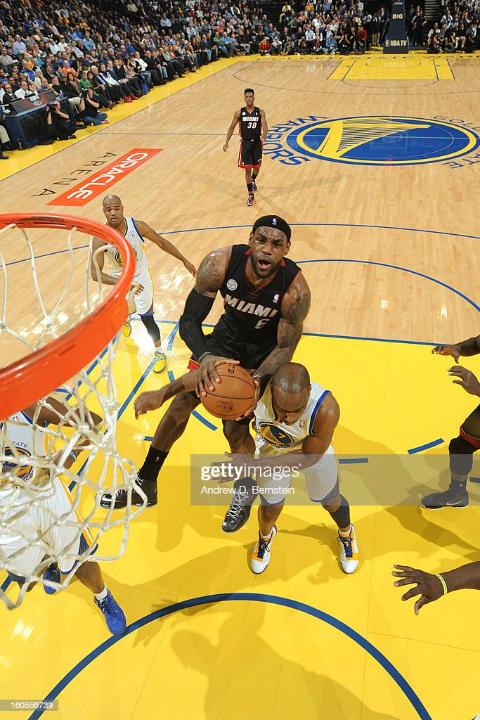 <a gi-track='captionPersonalityLinkClicked' href=/galleries/search?phrase=LeBron+James&family=editorial&specificpeople=201474 ng-click='$event.stopPropagation()'>LeBron James</a> #6 of the Miami Heat goes to the basket against the Golden State Warriors on January 16, 2013 at Oracle Arena in Oakland, California.