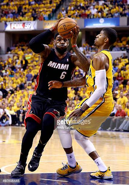 LeBron James of the Miami Heat goes to the basket as Paul George of the Indiana Pacers defends during Game Two of the Eastern Conference Finals of...
