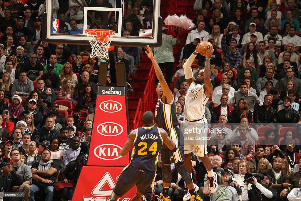 <a gi-track='captionPersonalityLinkClicked' href=/galleries/search?phrase=LeBron+James&family=editorial&specificpeople=201474 ng-click='$event.stopPropagation()'>LeBron James</a> #6 of the Miami Heat goes to the basket during the game between the Utah Jazz and the Miami Heat on December 22, 2012 at American Airlines Arena in Miami, Florida.