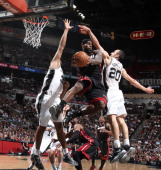 LeBron James of the Miami Heat goes up against Manu Ginobili of the San Antonio Spurs during Game Four of the 2013 NBA Finals on June 13 2013 at the...