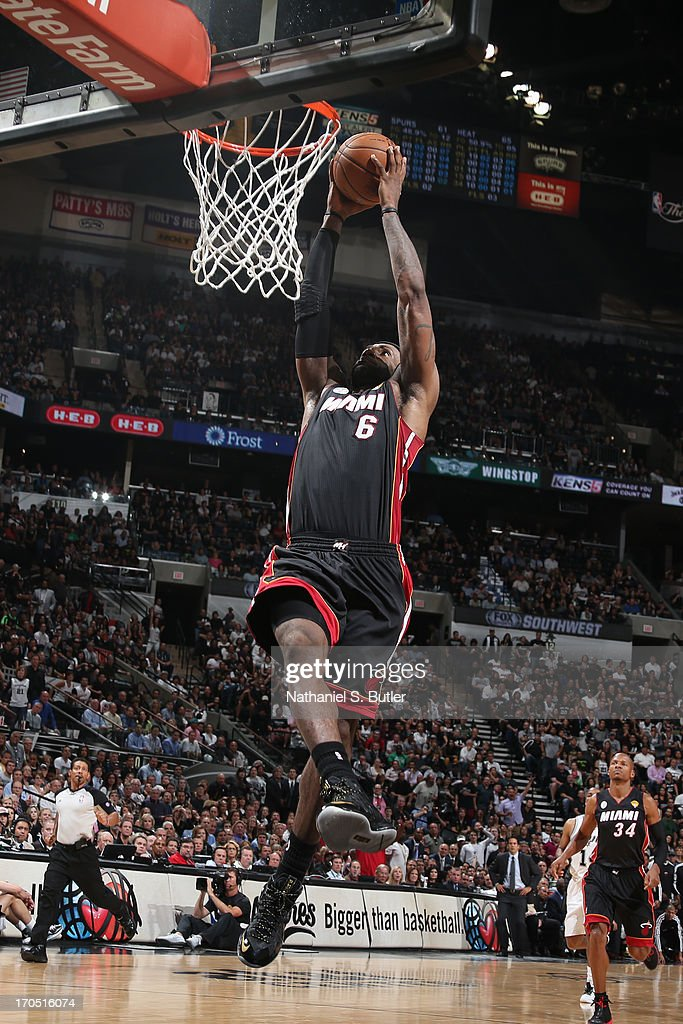 <a gi-track='captionPersonalityLinkClicked' href=/galleries/search?phrase=LeBron+James&family=editorial&specificpeople=201474 ng-click='$event.stopPropagation()'>LeBron James</a> #6 of the Miami Heat goes up for a dunk while playing against the San Antonio Spurs in Game Four of the 2013 NBA Finals on June 13, 2013 at the AT&T Center in San Antonio, Texas.