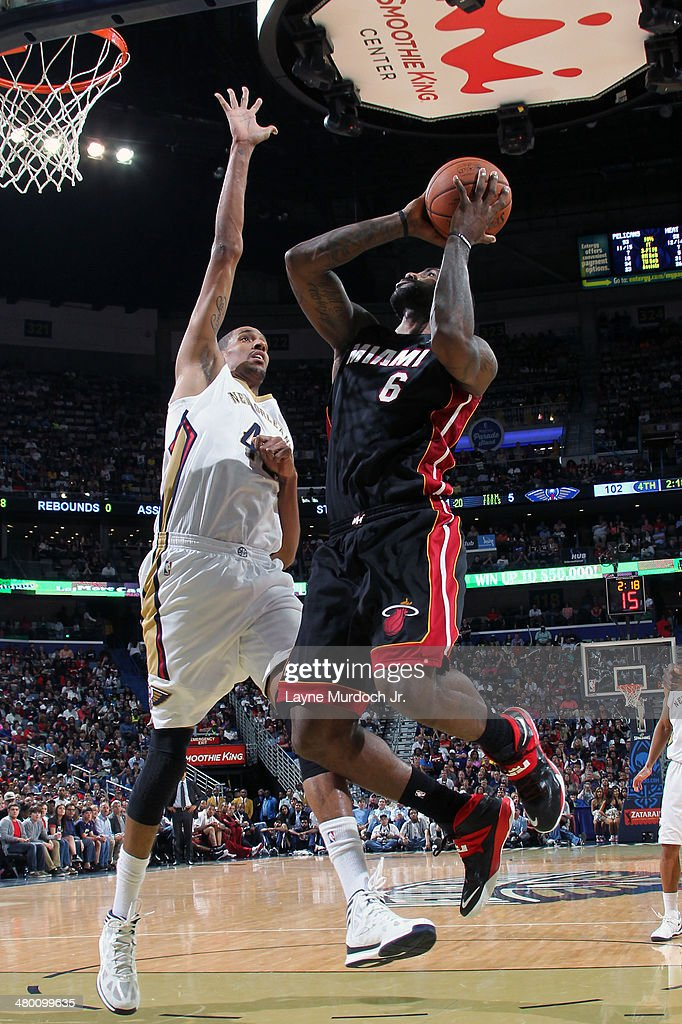 LeBron James #6 of the Miami Heat goes up for a shot against the New Orleans Pelicans on March 22, 2014 at the Smoothie King Center in New Orleans, Louisiana.