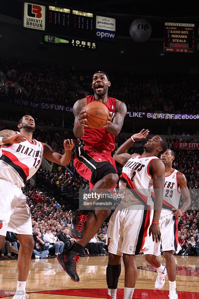 <a gi-track='captionPersonalityLinkClicked' href=/galleries/search?phrase=LeBron+James&family=editorial&specificpeople=201474 ng-click='$event.stopPropagation()'>LeBron James</a> #6 of the Miami Heat goes up for a shot against <a gi-track='captionPersonalityLinkClicked' href=/galleries/search?phrase=Wesley+Matthews&family=editorial&specificpeople=804816 ng-click='$event.stopPropagation()'>Wesley Matthews</a> #2 and <a gi-track='captionPersonalityLinkClicked' href=/galleries/search?phrase=LaMarcus+Aldridge&family=editorial&specificpeople=453277 ng-click='$event.stopPropagation()'>LaMarcus Aldridge</a> #12 of the Portland Trail Blazers during a game on January 9, 2011 at the Rose Garden Arena in Portland, Oregon.