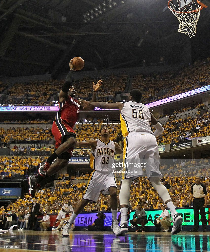 <a gi-track='captionPersonalityLinkClicked' href=/galleries/search?phrase=LeBron+James&family=editorial&specificpeople=201474 ng-click='$event.stopPropagation()'>LeBron James</a> #6 of the Miami Heat goes up for a shot between <a gi-track='captionPersonalityLinkClicked' href=/galleries/search?phrase=Danny+Granger&family=editorial&specificpeople=553769 ng-click='$event.stopPropagation()'>Danny Granger</a> #33 and <a gi-track='captionPersonalityLinkClicked' href=/galleries/search?phrase=Roy+Hibbert&family=editorial&specificpeople=725128 ng-click='$event.stopPropagation()'>Roy Hibbert</a> #55 of the Indiana Pacers in Game Three of the Eastern Conference Semifinals in the 2012 NBA Playoffs at Bankers Life Fieldhouse on May 17, 2012 in Indianapolis, Indiana. The Pacers defeated the Heat 94-75.