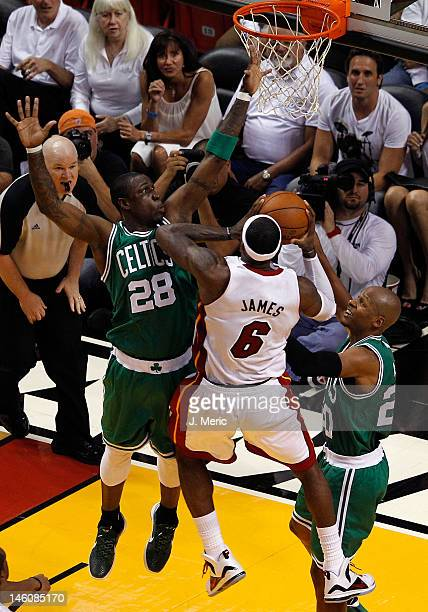 LeBron James of the Miami Heat goes up for a shot between Mickael Pietrus and Ray Allen of the Boston Celtics in the first half in Game Seven of the...