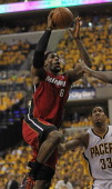 LeBron James of the Miami Heat goes up for a shot over Danny Granger of the Indiana Pacers in Game Three of the Eastern Conference Semifinals in the...