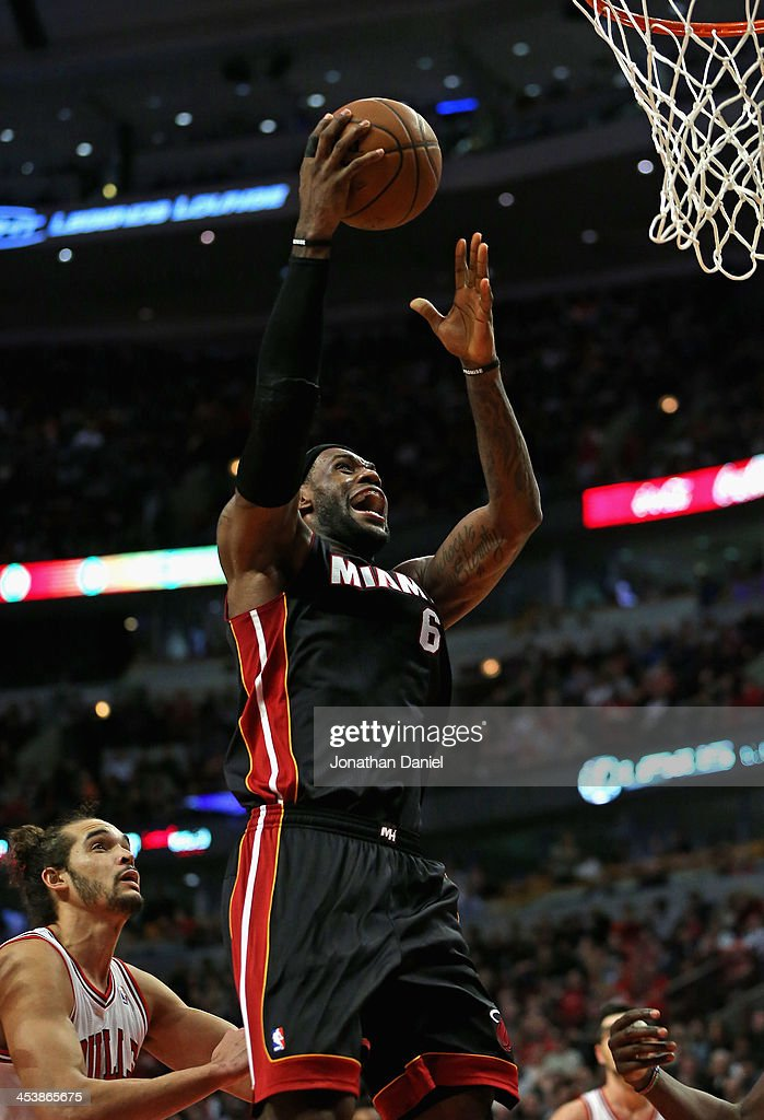 <a gi-track='captionPersonalityLinkClicked' href=/galleries/search?phrase=LeBron+James&family=editorial&specificpeople=201474 ng-click='$event.stopPropagation()'>LeBron James</a> #6 of the Miami Heat goes up for a shot past <a gi-track='captionPersonalityLinkClicked' href=/galleries/search?phrase=Joakim+Noah&family=editorial&specificpeople=699038 ng-click='$event.stopPropagation()'>Joakim Noah</a> #13 of the Chicago Bulls at the United Center on December 5, 2013 in Chicago, Illinois.