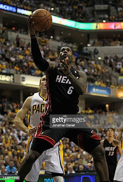 LeBron James of the Miami Heat goes up for a shot past Lou Amundson of the Indiana Pacers on his way to a gamehigh 40 points in Game Four of the...
