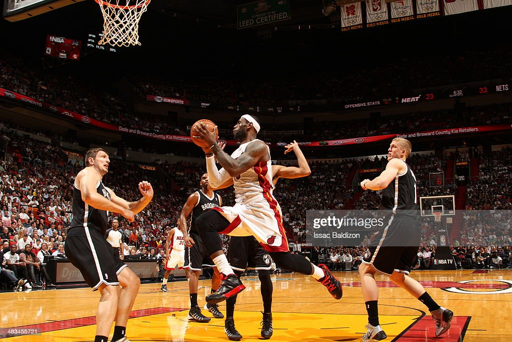 LeBron James #6 of the Miami Heat goes up for the layup against the Brooklyn Nets during game on April 8, 2014 at American Airlines Arena in Miami, Florida.