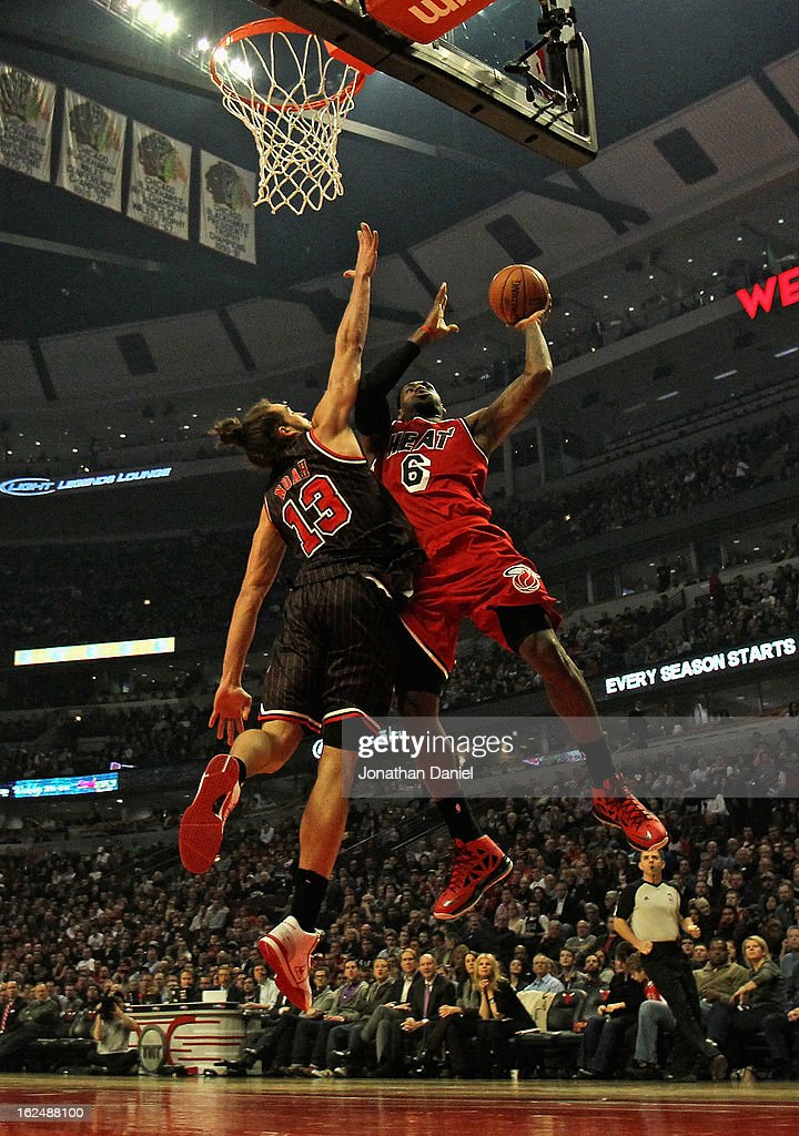 LeBron James #6 of the Miami Heat goes up for the shot as Joakim Noah #13 of the Chicago Bulls goes for the block at the United Center on February 21, 2013 in Chicago, Illinois. The Heat defeated the Bulls 86-67.