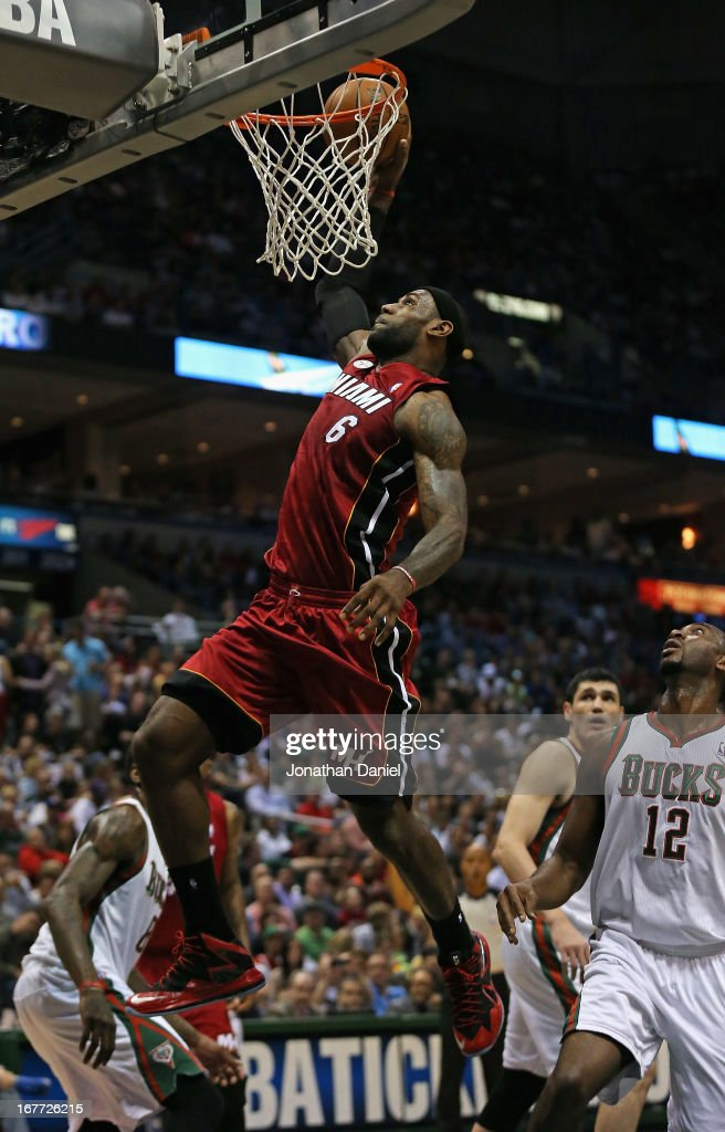 <a gi-track='captionPersonalityLinkClicked' href=/galleries/search?phrase=LeBron+James&family=editorial&specificpeople=201474 ng-click='$event.stopPropagation()'>LeBron James</a> #6 of the Miami Heat goes up over <a gi-track='captionPersonalityLinkClicked' href=/galleries/search?phrase=Luc+Richard+Mbah+a+Moute&family=editorial&specificpeople=699041 ng-click='$event.stopPropagation()'>Luc Richard Mbah a Moute</a> #12 of the Milwaukee Bucks in Game Four of the Eastern Conference Quarterfinals during the 2013 NBA Playoffs at the Bradley Center on April 28, 2013 in Milwaukee, Wisconsin.