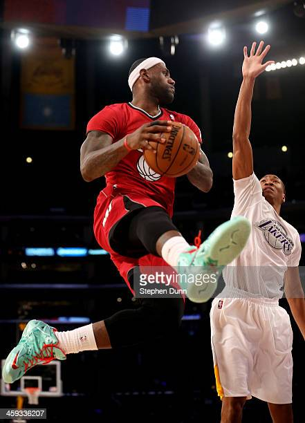 LeBron James of the Miami Heat goes up with the ball against Wesley Johnson of the Los Angeles Lakers at Staples Center on December 25 2013 in Los...