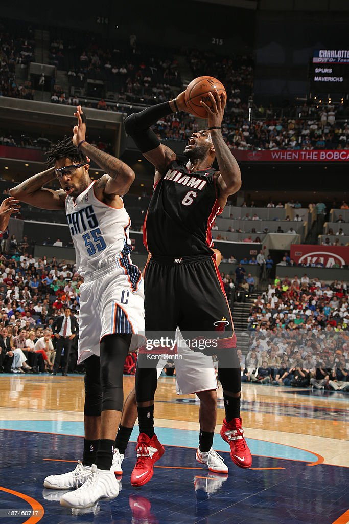 LeBron James #6 of the Miami Heat grabs a rebound against the Charlotte Bobcats in Game Four of the Eastern Conference Quarterfinals against the Charlotte Bobcats in the 2014 NBA Playoffs at the Time Warner Cable Arena on April 28, 2014 in Charlotte, North Carolina.