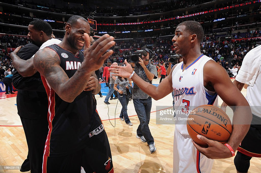 <a gi-track='captionPersonalityLinkClicked' href=/galleries/search?phrase=LeBron+James&family=editorial&specificpeople=201474 ng-click='$event.stopPropagation()'>LeBron James</a> #6 of the Miami Heat greets <a gi-track='captionPersonalityLinkClicked' href=/galleries/search?phrase=Chris+Paul&family=editorial&specificpeople=212762 ng-click='$event.stopPropagation()'>Chris Paul</a> #3 of the Los Angeles Clippers following their game at the Staples Center on November 14, 2012 in Los Angeles, California.