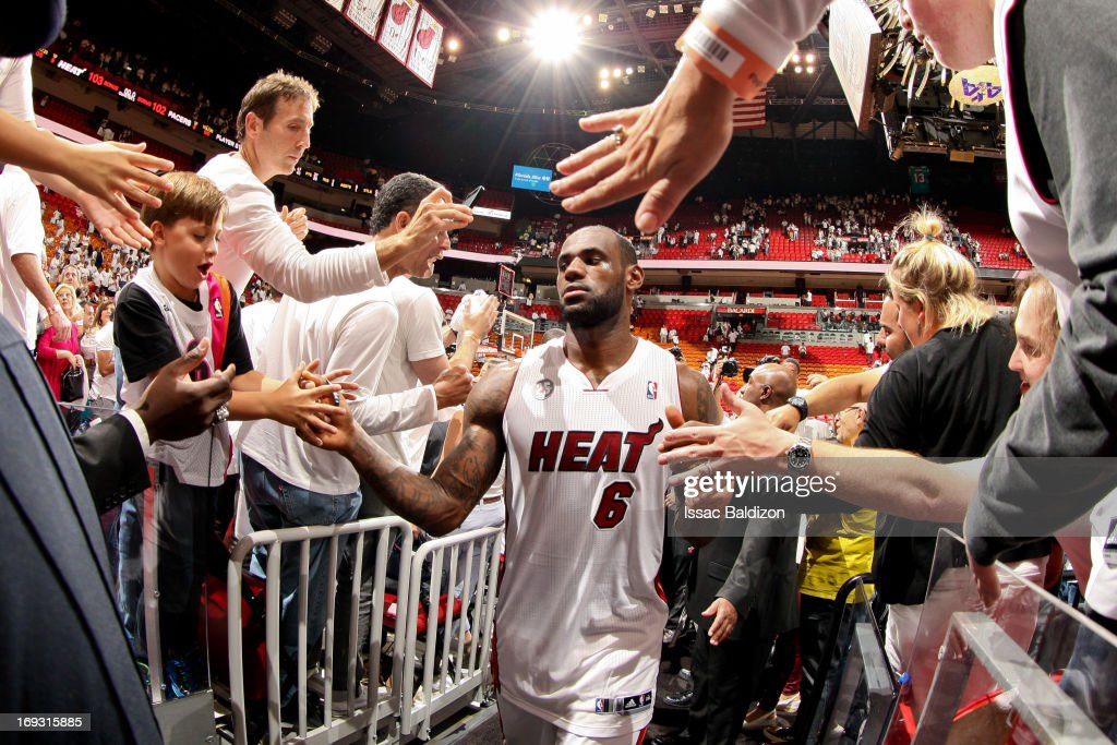 LeBron James #6 of the Miami Heat greets fans following his team's victory against the Indiana Pacers in Game One of the Eastern Conference Finals during the 2013 NBA Playoffs on May 22, 2013 at American Airlines Arena in Miami, Florida.