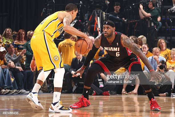 LeBron James of the Miami Heat guards George Hill of the Indiana Pacers in Game Two of the Eastern Conference Finals during the 2014 NBA Playoffs at...