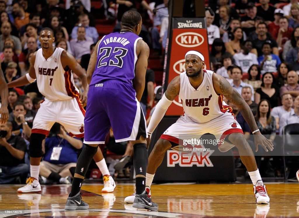 <a gi-track='captionPersonalityLinkClicked' href=/galleries/search?phrase=LeBron+James&family=editorial&specificpeople=201474 ng-click='$event.stopPropagation()'>LeBron James</a> #6 of the Miami Heat guards <a gi-track='captionPersonalityLinkClicked' href=/galleries/search?phrase=Marcus+Thornton+-+Basketball+Player+-+Born+1987&family=editorial&specificpeople=4679329 ng-click='$event.stopPropagation()'>Marcus Thornton</a> #23 of the Sacramento Kings during a game at American Airlines Arena on February 21, 2012 in Miami, Florida.