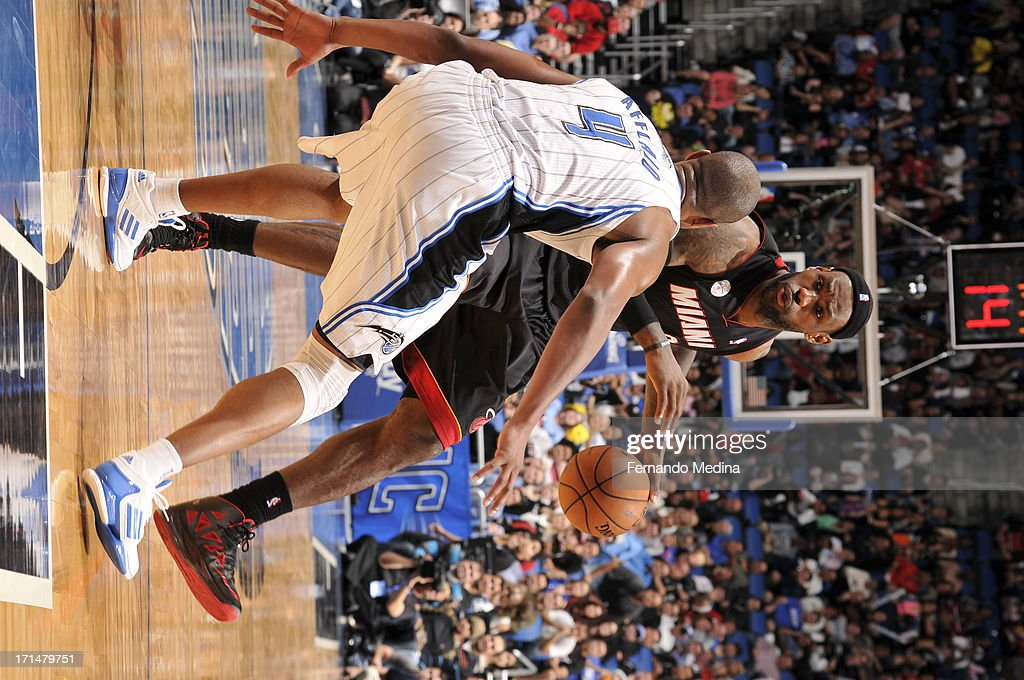 LeBron James #6 of the Miami Heat handles the ball against Arron Afflalo #4 of the Orlando Magic on December 31, 2012 at Amway Center in Orlando, Florida.
