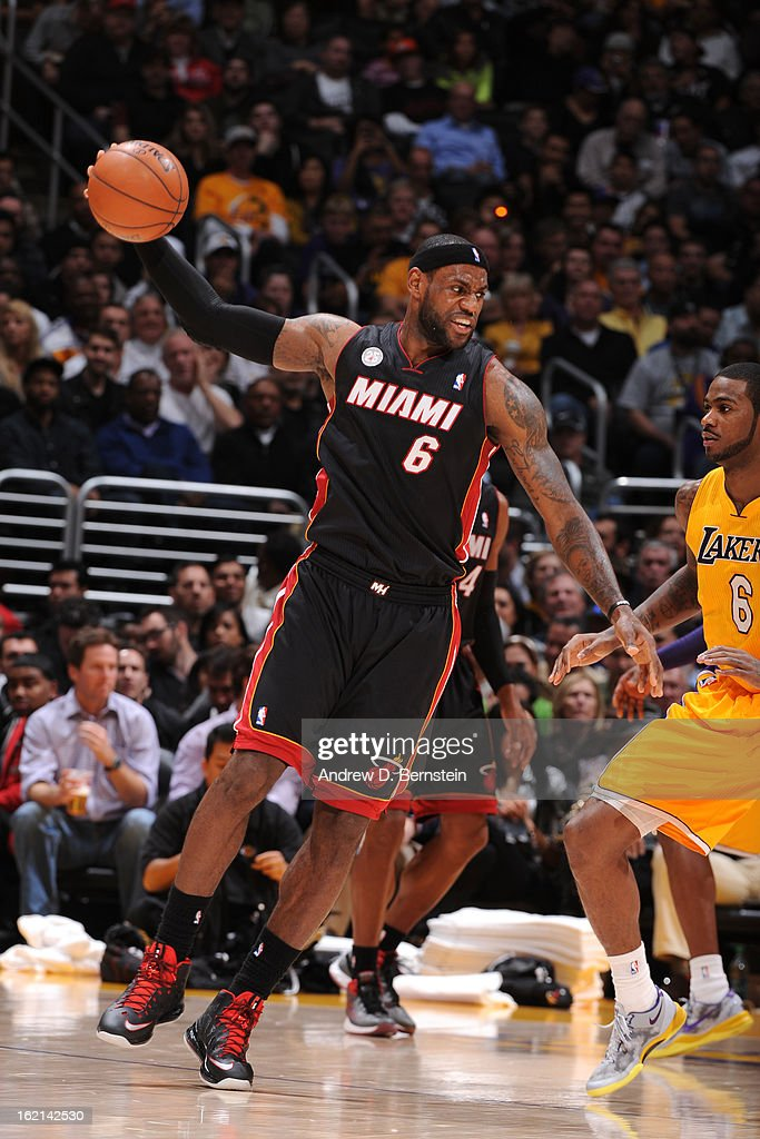 LeBron James #6 of the Miami Heat handles the ball against Earl Clark #6 of the Los Angeles Lakers at Staples Center on January 17, 2013 in Los Angeles, California.