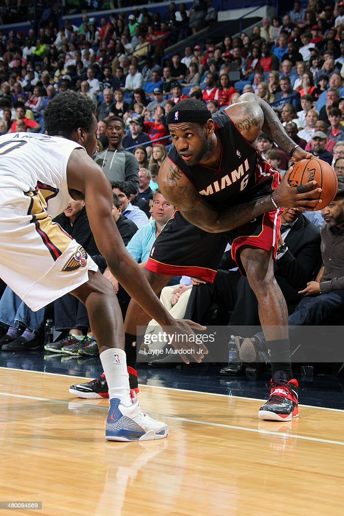LeBron James #6 of the Miami Heat handles the ball against the New Orleans Pelicans on March 22, 2014 at the Smoothie King Center in New Orleans, Louisiana.