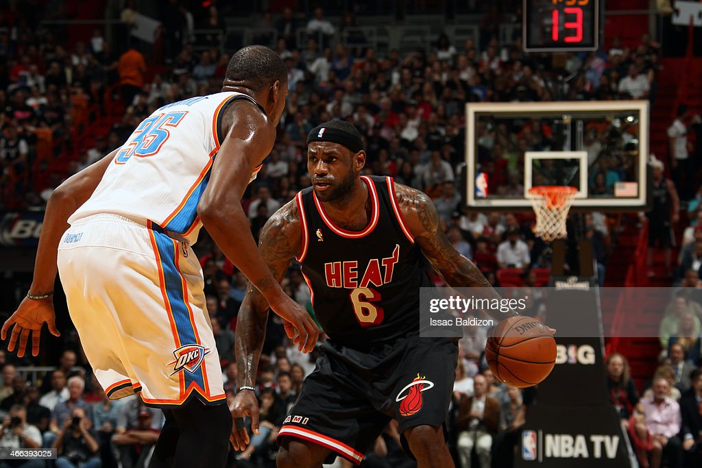 <a gi-track='captionPersonalityLinkClicked' href=/galleries/search?phrase=LeBron+James&family=editorial&specificpeople=201474 ng-click='$event.stopPropagation()'>LeBron James</a> #6 of the Miami Heat handles the ball against the Oklahoma City Thunder at the American Airlines Arena in Miami, Florida on Jan. 29, 2014.