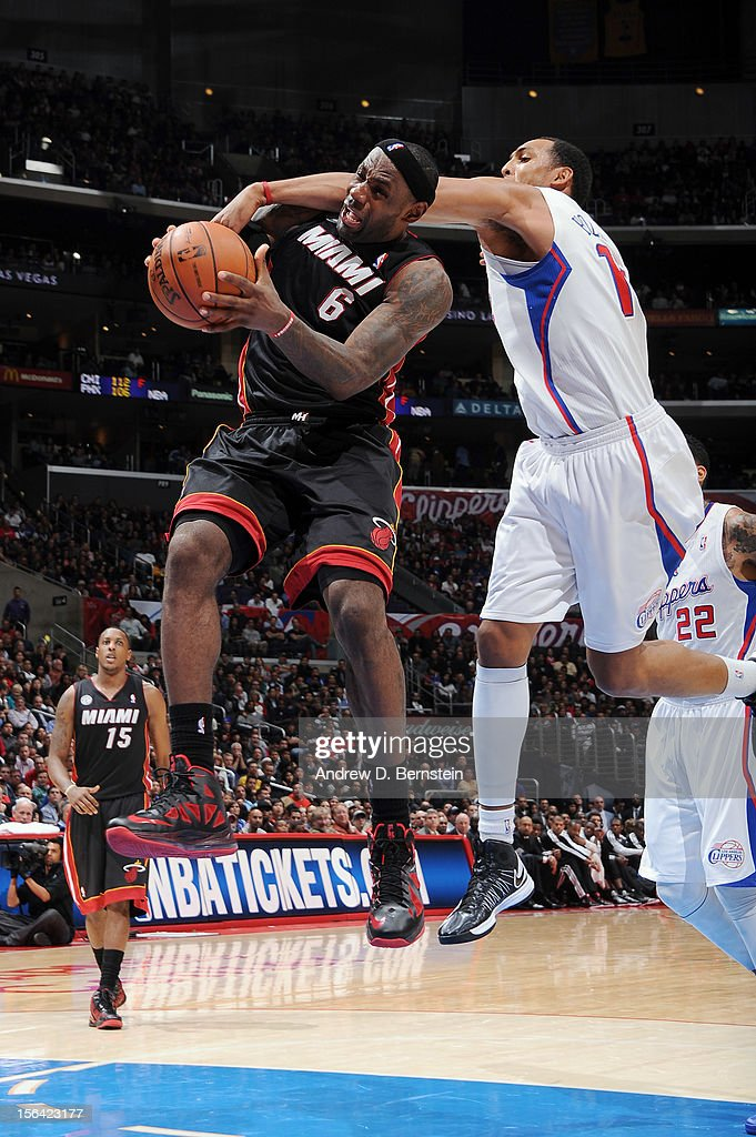 <a gi-track='captionPersonalityLinkClicked' href=/galleries/search?phrase=LeBron+James&family=editorial&specificpeople=201474 ng-click='$event.stopPropagation()'>LeBron James</a> #6 of the Miami Heat has a shot attempt contested by <a gi-track='captionPersonalityLinkClicked' href=/galleries/search?phrase=Ryan+Hollins&family=editorial&specificpeople=182556 ng-click='$event.stopPropagation()'>Ryan Hollins</a> #15 of the Los Angeles Clippers at the Staples Center on November 14, 2012 in Los Angeles, California.