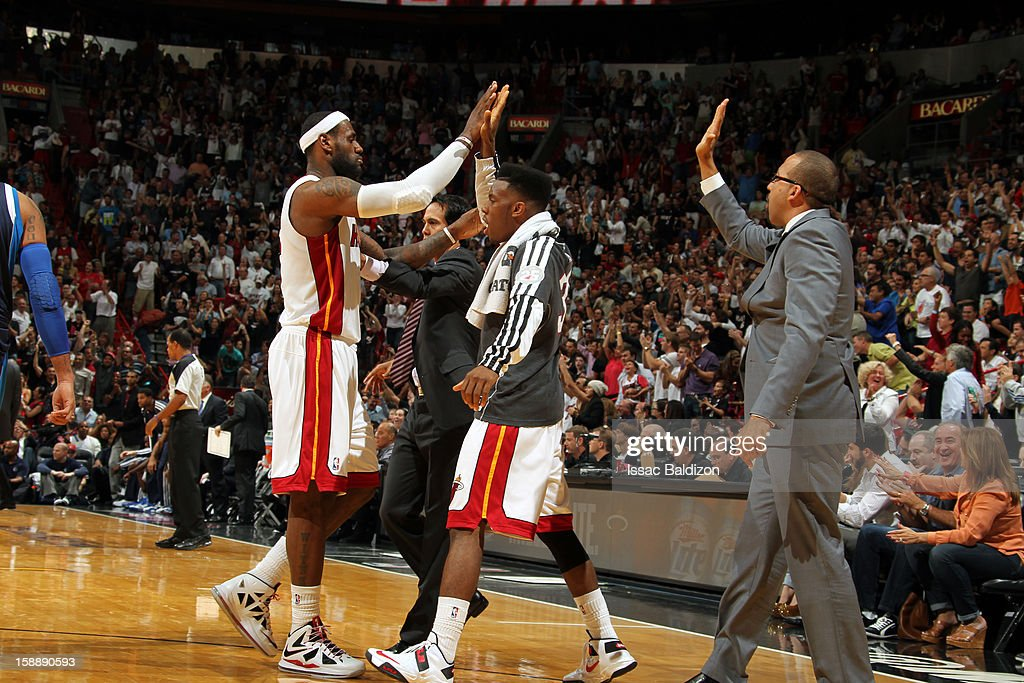 <a gi-track='captionPersonalityLinkClicked' href=/galleries/search?phrase=LeBron+James&family=editorial&specificpeople=201474 ng-click='$event.stopPropagation()'>LeBron James</a> #6 of the Miami Heat high fives teammate <a gi-track='captionPersonalityLinkClicked' href=/galleries/search?phrase=Norris+Cole&family=editorial&specificpeople=5770147 ng-click='$event.stopPropagation()'>Norris Cole</a> #30 during the game against the Dallas Mavericks on January 2, 2013 at American Airlines Arena in Miami, Florida.