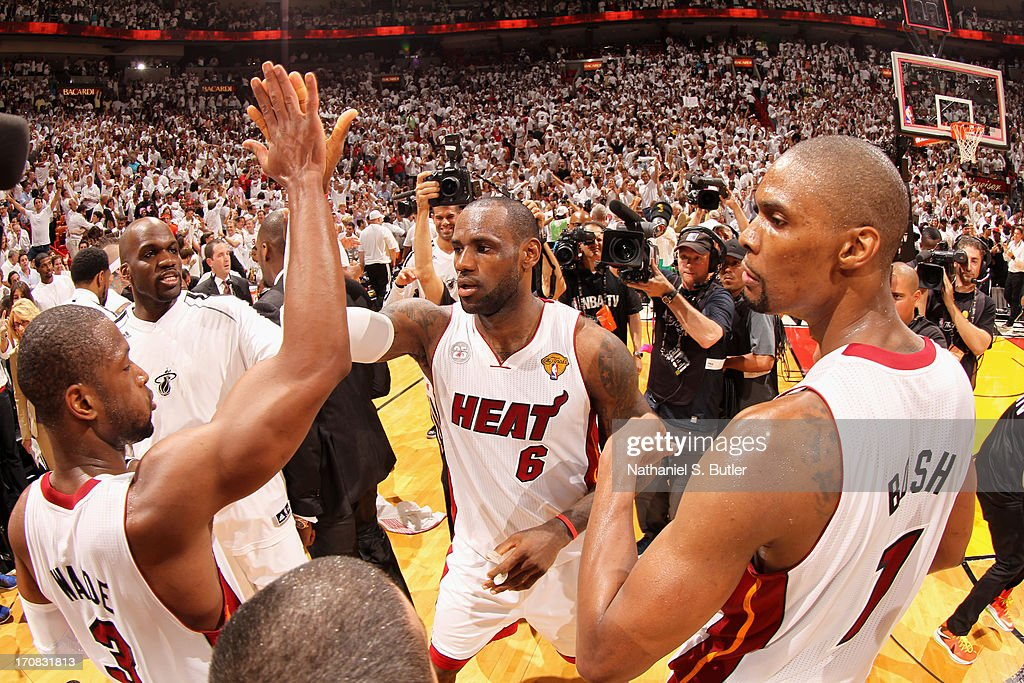 LeBron James #6 of the Miami Heat high-fives teammate Dwyane Wade #3 of the Miami Heat at the end of Game Six of the 2013 NBA Finals on June 18, 2013 at American Airlines Arena in Miami, Florida.